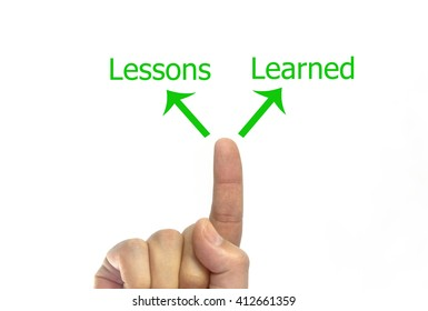 hand writing lessons learned arrow figure on a transparent wipe board.