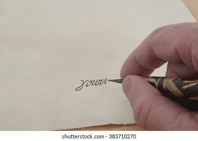 Hand writing a letter.