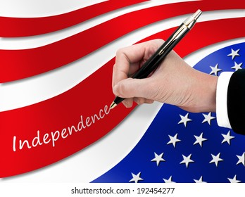 Hand writing massage Independence on American flag.