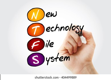 Hand writing NTFS New Technology File System with marker, acronym concept