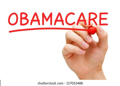Hand writing ObamaCare with red marker on transparent wipe board.