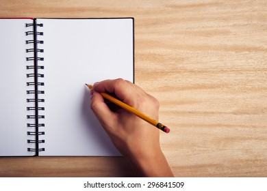 Hand writing on a blank empty notebook
