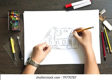 Hand writing on a blueprint  house