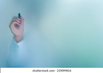 hand writing on blurred glass wall, abstract background with space editable