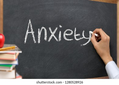 Hand writing on a chalk board or blackboard the word Anxiety in a mental health class. Psychology disorder concept