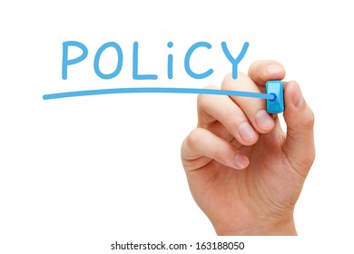 Hand writing Policy with blue marker on transparent wipe board.