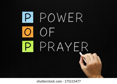 Hand writing POP - Power Of Prayer with white chalk on blackboard.