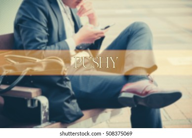 Hand writing PUSHY  with the abstract background. The word PUSHY represent the meaning of word as concept in stock photo.