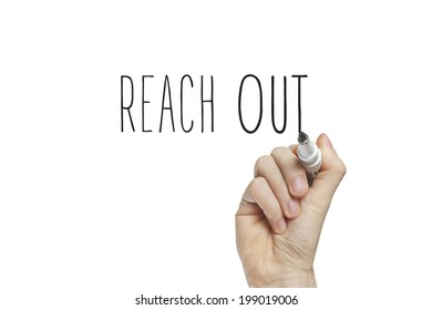 Hand writing reach out on a white board