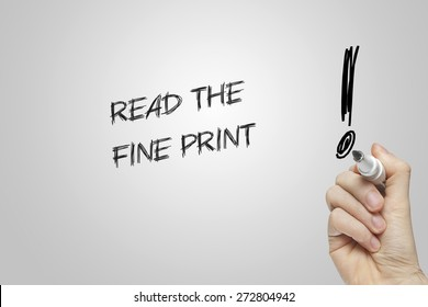 Hand writing read the fine print on grey background