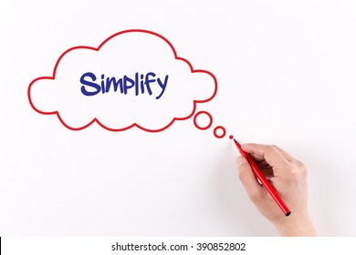 Hand writing Simplify on white paper, view from above