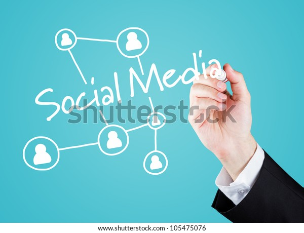 Hand writing social media to screen. Blue Background