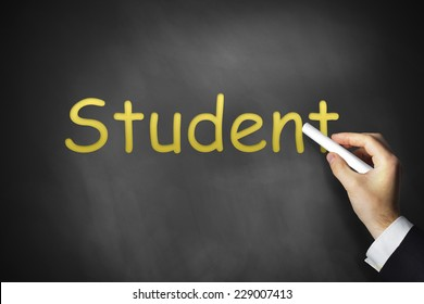 hand writing student on black chalkboard university