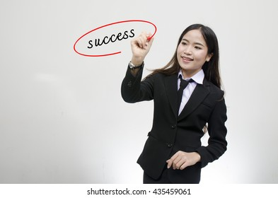 Hand writing success with black marker on visual screen. Isolated on gray background. Business, technology, internet concept. Stock Photo