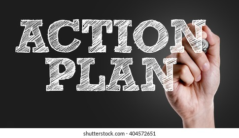 Hand writing the text: Action Plan