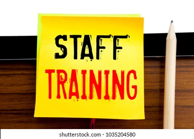 Hand writing text caption inspiration   Staff Training. Business concept for Teaching or Education written on sticky note paper on wooden and tablet background.