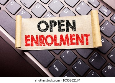 Hand writing text caption inspiration showing Open Enrolment. Business concept for Medicine Doctor Enroll written on sticky note paper on dark keyboard background.