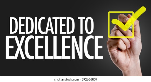 Hand writing the text: Dedicated to Excellence
