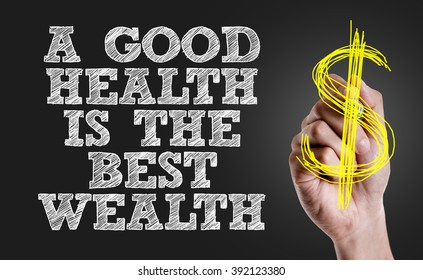 Hand writing the text: A Good Health is the Best Wealth