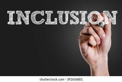 Hand writing the text: Inclusion