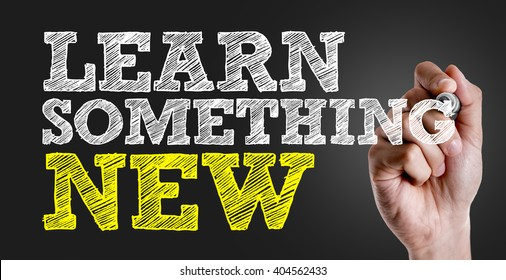Hand writing the text: Learn Something New