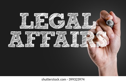 Hand writing the text: Legal Affairs