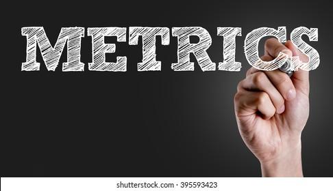 Hand writing the text: Metrics