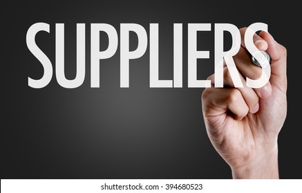 Hand writing the text: Suppliers