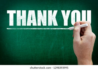 Hand writing the text THANK YOU on the blackboard