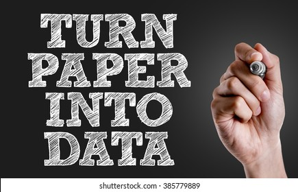Hand writing the text: Turn Paper Into Data