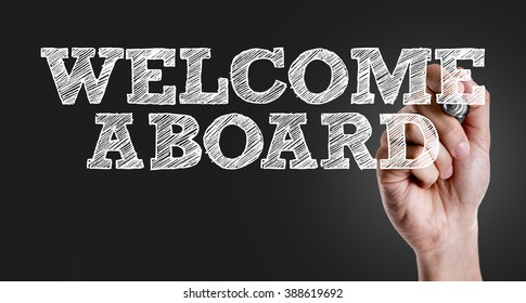 Hand writing the text: Welcome Aboard