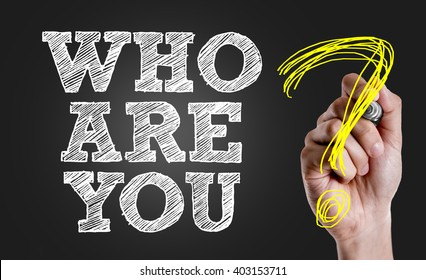 Hand writing the text: Who Are You?