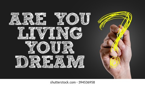Hand writing the text: Are You Living Your Dream?