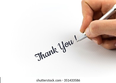 """Hand writing """"Thank You!""""  on white sheet of paper."""