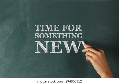 """Hand Writing """"Time for Something New"""" on Blackboard"""