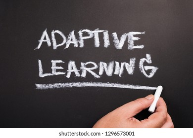Hand writing topic of Adaptive Learning on chalkboard
