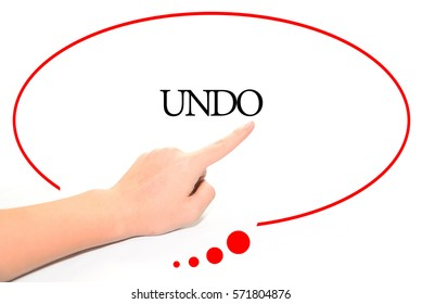 Hand writing UNDO  with the abstract background. The word UNDO represent the meaning of word as concept in stock photo.