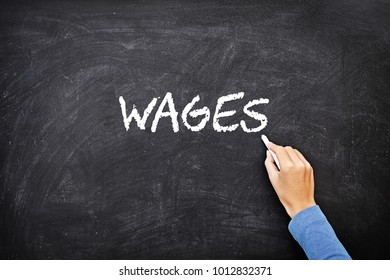 "Hand writing ""WAGES"" on blackboard."
