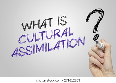 Hand writing what is cultural assimilation on grey background