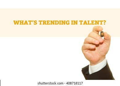 Hand writing WHAT TRENDING IN TALENT? question on a transparent wipe board.