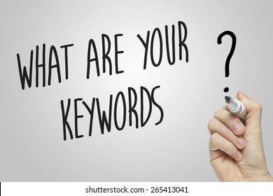 Hand writing what are your keywords on grey background