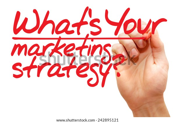 Hand writing What's Your Marketing Strategy with red marker, business concept