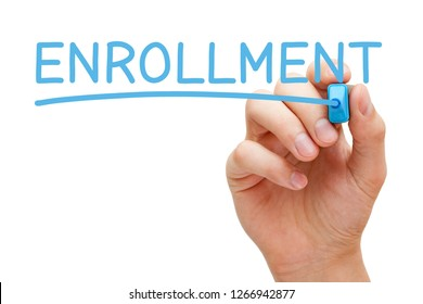 Hand writing the word Enrollment with blue marker on transparent wipe board isolated on white.