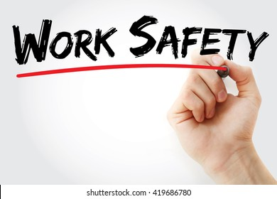 Hand writing Work Safety with marker, health concept background