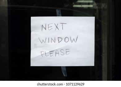 """Hand written sign that says, """"NEXT WINDOW PLEASE"""""""