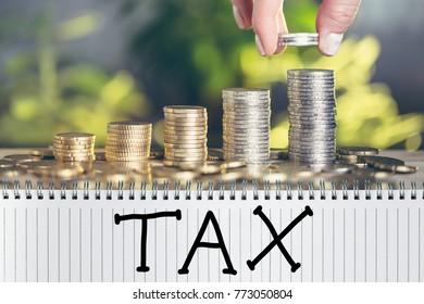 Hand written word tax. Business concept, saving on tax.