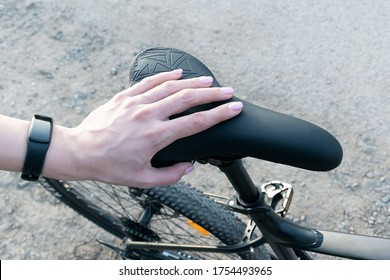 Hand of a young girl on a bicycle seat. Sports weekend. Sport lifestyle. Mountain bike.