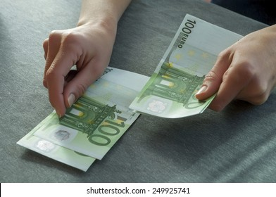 in the hand of a young girl a wad of money, she thinks they may be go for shopping, and maybe considers your income