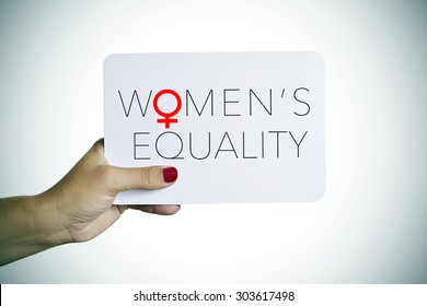 the hand of a young woman holding a signboard with the text womens equality written in it