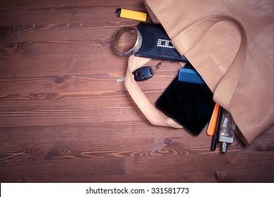 handbags. everyday woman's things. desktop dark wood